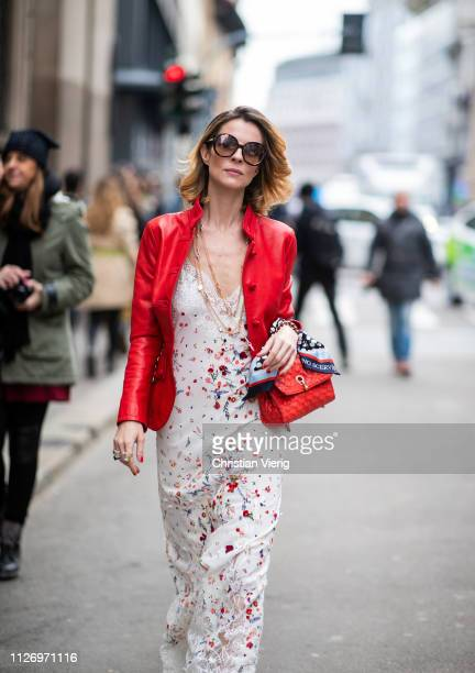 Roberta Ruiu wearing dress with print red jacket attends the Ermanno Scervino show at Milan Fashion Week Autumn/Winter 2019/20 on February 23 2019 in...