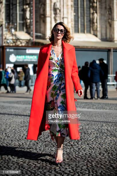Roberta Ruiu wearing red coat and Ermanno Scervino floreal dress is seen outside Stella Jean on Day 5 Milan Fashion Week Autumn/Winter 2019/20 on...