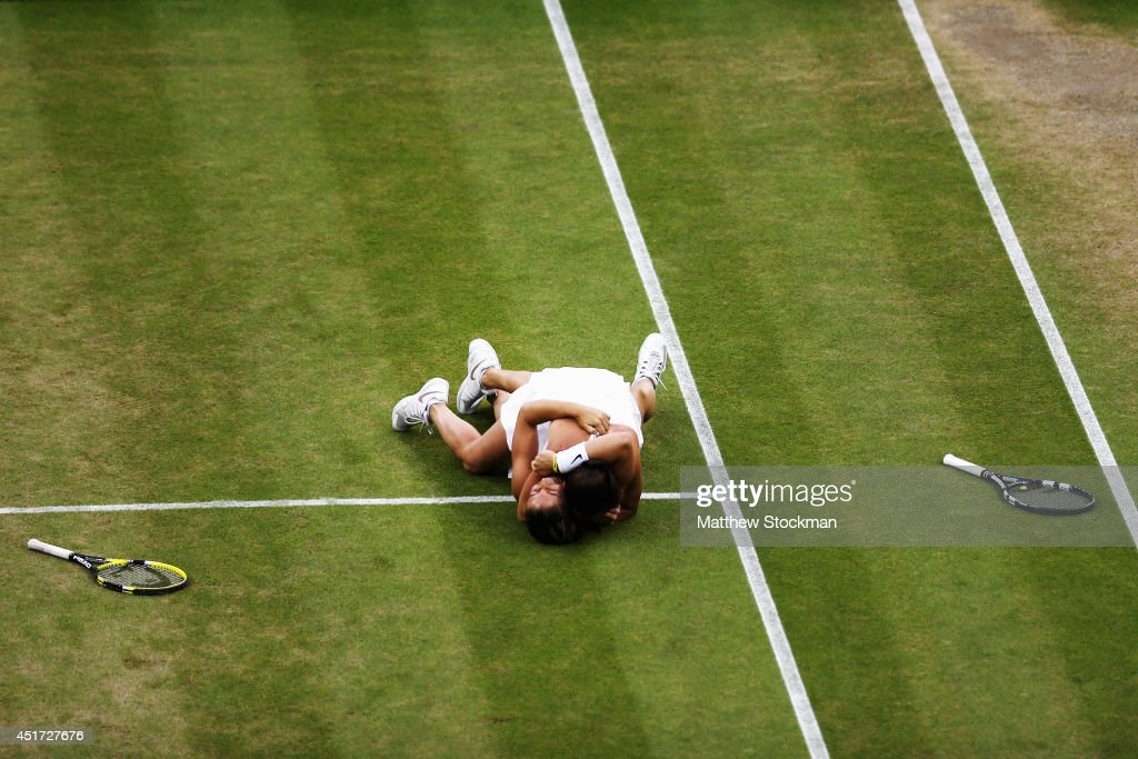 Roberta Vinci (top) and Sara Errani of Italy celebrate winning their Ladies Doubles Final match against Timea Babos of Hungary and Kristina Mladenovic of France on day twelve of the Wimbledon Lawn Tennis Championships at the All England Lawn Tennis and Croquet Club on July 5, 2014 in London, England.