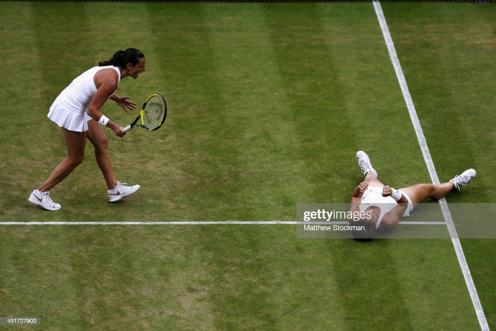 Roberta Vinci (l) and Sara Errani of Italy celebrate winning their Ladies Doubles Final match against Timea Babos of Hungary and Kristina Mladenovic of France on day twelve of the Wimbledon Lawn Tennis Championships at the All England Lawn Tennis and Croquet Club on July 5, 2014 in London, England.