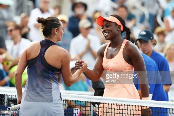 Roberta Vinci of Italy and Sloane Stephens of the United States shake hands after their first round Women's Singles match on Day One of the 2017 US...