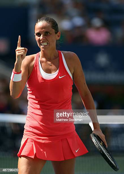 Roberta Vinci of Italy celebrates a point against Kristina Mladenovic of France during their Women's Singles Quarterfinals Round match on Day Nine of...