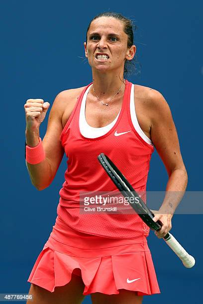 Roberta Vinci of Italy celebrates a point in the third set against Serena Williams of the United States during their Women's Singles Semifinals match...