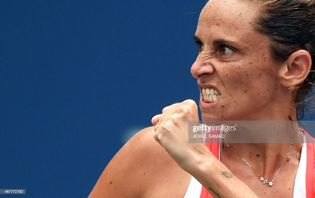 Roberta Vinci of Italy celebrates winning a point against Serena Williams of the US during their 2015 US Open Women's singles semifinals match at the USTA Billie Jean King National Tennis Center in New York on September 11, 2015. Vinci won 2-6, 6-4, 6-4. AFP PHOTO/JEWEL SAMAD / AFP PHOTO / Jewel SAMAD