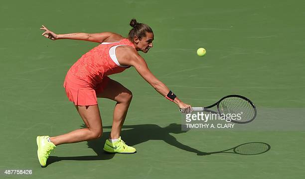 Roberta Vinci of Italy chases down a return from Serena Williams of the US during their US Open 2015 women's singles semifinals match at the USTA...