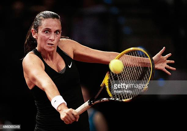 Roberta Vinci of Italy hits a backhand during her first round match against Annika Beck of Germany during day 2 of the Porsche Tennis Grand Prix 2014...