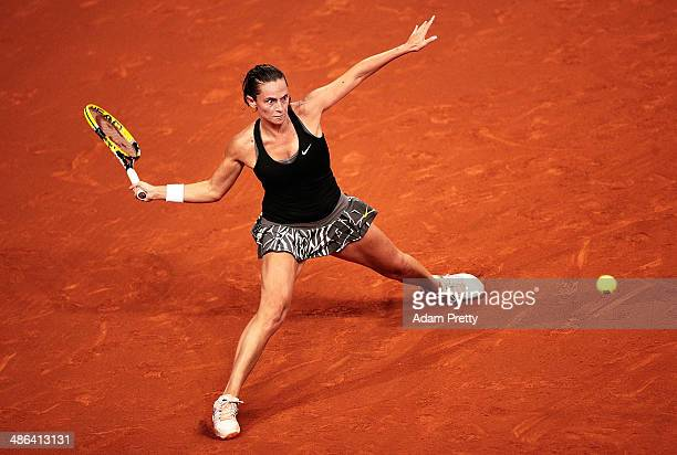 Roberta Vinci of Italy hits a forehand during her match against Agnieszka Radwanska of Poland on day four of the Porsche Tennis Grand Prix 2014 at...