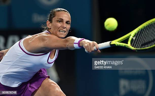 Roberta Vinci of Italy hits a return against Victoria Azarenka of Belarus during their women's singles quarterfinal match on the fifth day of the...