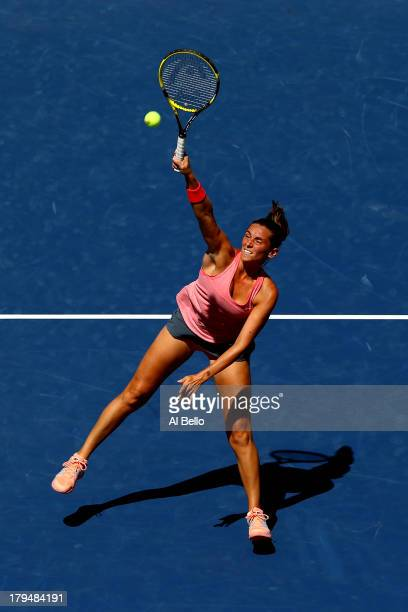 Roberta Vinci of Italy leaps to volley the ball during her women's singles quarterfinal match against Flavia Pennetta of Italy on Day Ten of the 2013...