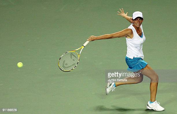 Roberta Vinci of Italy plays a backhand in her match against Flavia Pennetta of Italy during day one of the Toray Pan Pacific Open Tennis tournament...