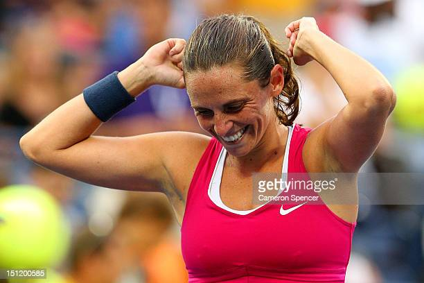 Roberta Vinci of Italy reacts against reacts after defeating Agnieszka Radwanska of Poland during their women's singles fourth round match on Day...