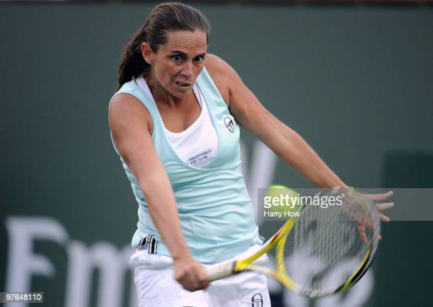Roberta Vinci of Italy returns a backhand in her match against Melanie Oudin of the United States during the BNP Paribas Open at the Indian Wells...