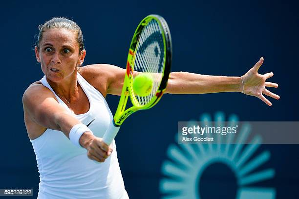Roberta Vinci of Italy returns a shot during a match against Johanna Larsson of Sweden on day 5 of the Connecticut Open at the Connecticut Tennis...