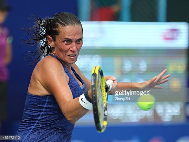 Roberta Vinci of Italy returns a shot during her match against Lin Zhu of China during day one of the 2014 WTA Guangzhou Open at Taint Sports Center...