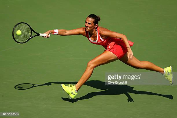 Roberta Vinci of Italy returns a shot to Kristina Mladenovic of France during their Women's Singles Quarterfinals Round match on Day Nine of the 2015...