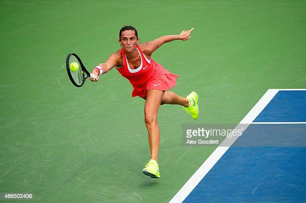 Roberta Vinci of Italy returns a shot to Mariana DuqueMarino of Colombia during their Women's Singles Third Round match on Day Five of the 2015 US...