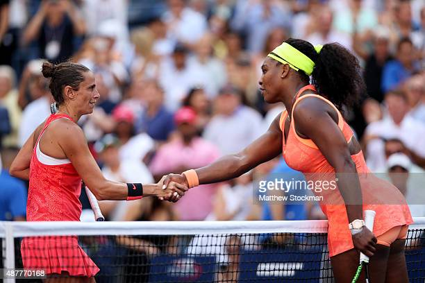Roberta Vinci of Italy shakes hands with Serena Williams of the United States after defeating her in their Women's Singles Semifinals match on Day...