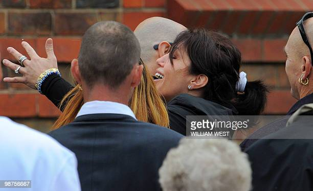 Roberta Williams , ex-wife of slain gangland killer Carl Williams embraces a mourner after the funeral service, in Melbourne on April 30, 2010. Carl...