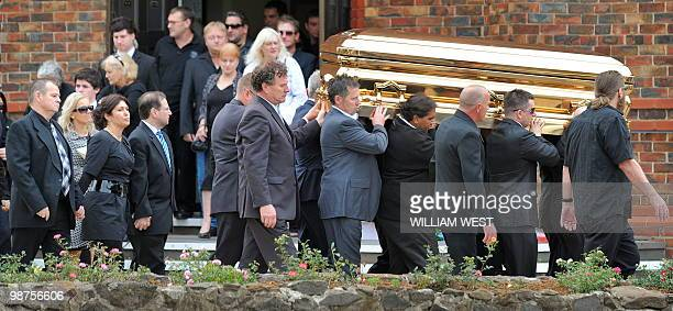 Roberta Williams , ex-wife of slain gangland killer Carl Williams and his father George , follow the gold-plated coffin out of the church as it...