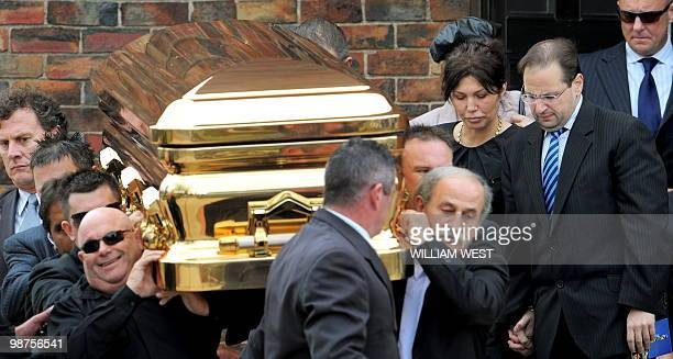 Roberta Williams , ex-wife of slain gangland killer Carl Williams, follows the gold-plated coffin out of the church as it leaves his funeral service,...