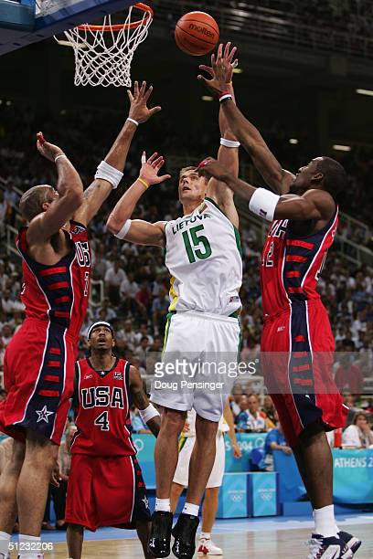 Robertas Javtokas of Lithuania shoots over the defense of Amare Stoudemire of the United States during the men's basketball bronze medal contest game...