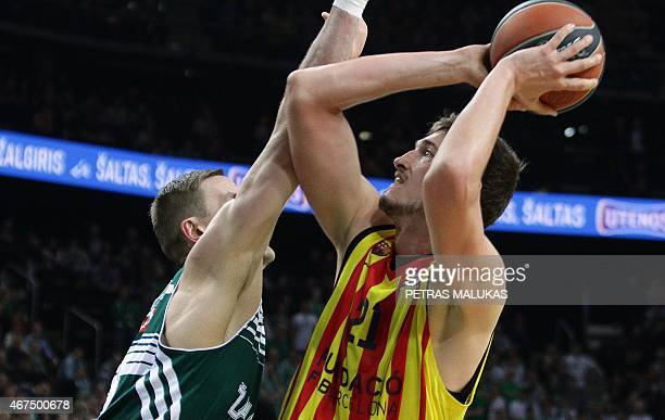 Robertas Javtokas of Zalgiris Kaunas vies with Barcelona's Tibor Pleiss during the Euroleague Top 16 Groupe E Basketball match Zalgiris Kaunas v FC...