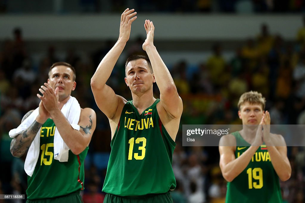 Robertas Javtokas, Paulius Jankunas and Mindaugas Kuzminskas of Lithuania celebrate after defeating Brazil 82-76 during a Men's preliminary round basketball game on Day 2 of the Rio 2016 Olympic Games at Carioca Arena 1 on August 7, 2016 in Rio de Janeiro, Brazil.