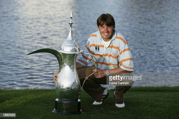 RobertJan Derksen of Holland poses with the winning trophy after winning the Dubai Desert Classic held on March 9 2003 at the Emirates Golf Club in...