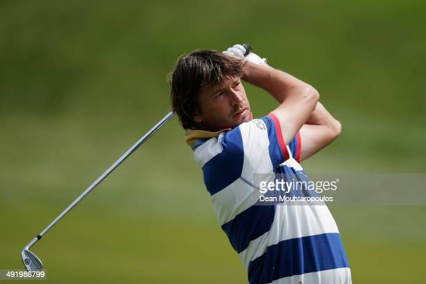 Robert-Jan Derksen of The Netherlands hits his second shot on the 1st hole during the final round of the Open de Espana held at PGA Catalunya Resort...