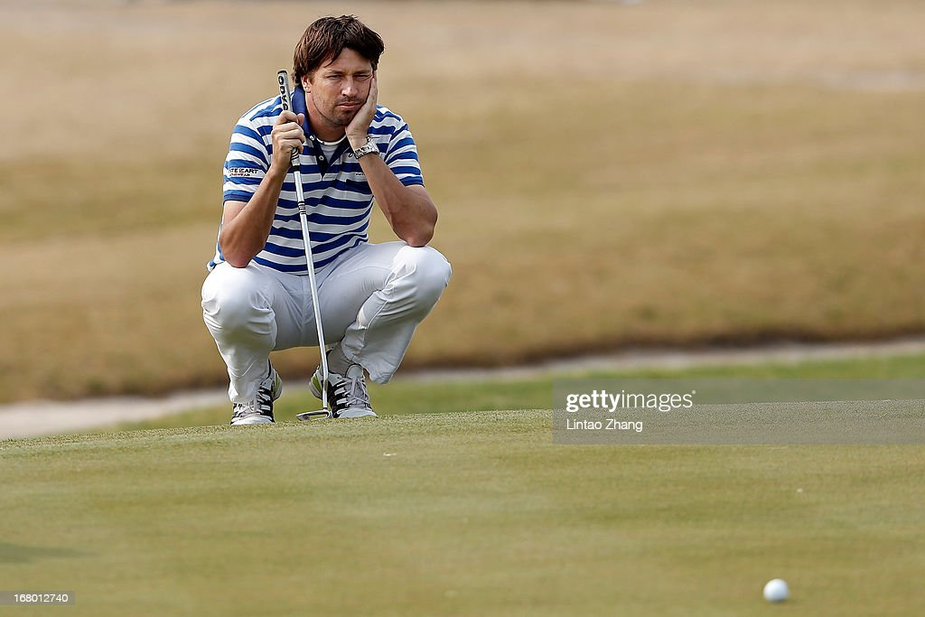 Robert-Jan Derksen of the Netherlands ines up a putt during the third day of the Volvo China Open at Binhai Lake Golf Course on May 4, 2013 in Tianjin, China.