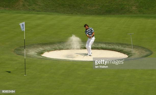 Robert-Jan Derksen of The Netherlands plays out of a bunker on the 8th green during the 2nd round of the BMW Asian Open at the Tomson Shanghai Pudong...