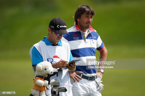 Robert-Jan Derksen of The Netherlands speaks to his caddie before he hits his second shot on the 1st hole during the final round of the Open de...