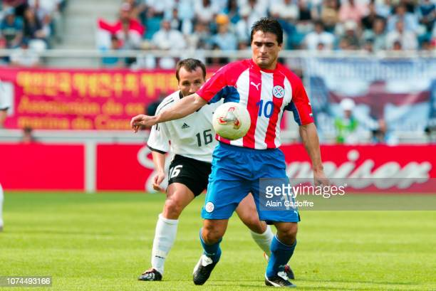 Roberto ACUNA and Jens JEREMIES during the FIFA World Cup match between Germany and Paraguay on June 15 2002 in Jeju Stadium South Korea