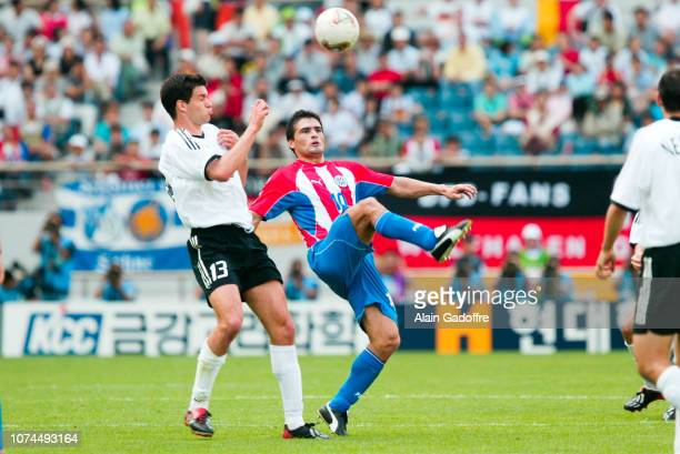 Roberto ACUNA and Mickael BALLACK during the FIFA World Cup match between Germany and Paraguay on June 15 2002 in Jeju Stadium South Korea