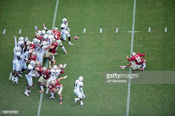 Roberto Aguayo of the Florida State Seminoles kicks to tack on the extra point during the second half against the Maryland Terrapins on October 5...