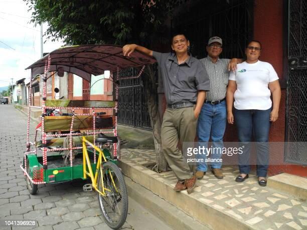 Roberto Alfredo Valdivia , Juan Salgado and Maria Eugenia Cantillano pose in front of the building of the La Isla Foundation in Chichigalpa,...