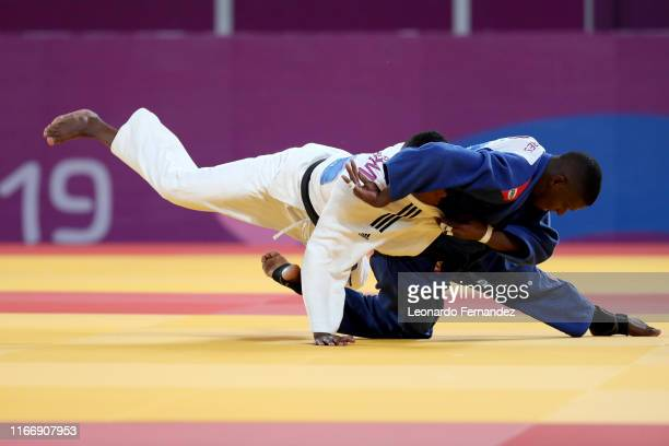 Roberto Almenares of Cuba competes against Elmert Ramirez of Dominican Republic during the Judo Men's -60 kg Bronze Medals on Day 13 of Lima 2019 Pan...