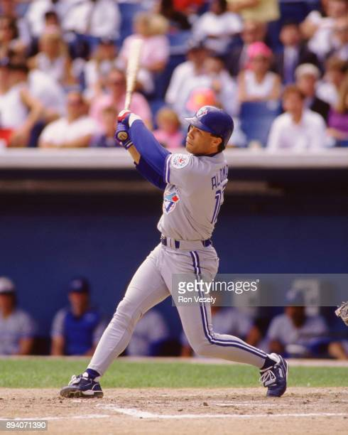 Roberto Alomar bats while playing in an MLB game during the 1991 season at Comiskey Park in Chicago Illinois