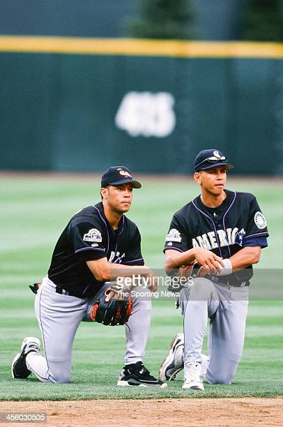 Roberto Alomar of the Baltimore Orioles and Alex Rodriguez of the Seattle Mariners during the AllStar Game on July 7 1998 at Coors Field in Denver...