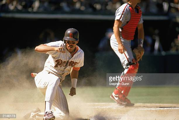 Roberto Alomar of the San Diego Padres slides into home during the 1989 season