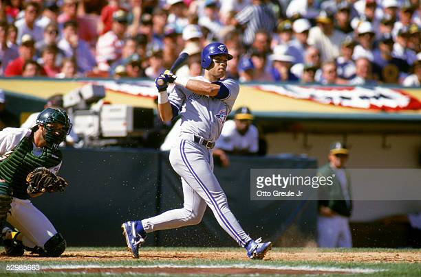 Roberto Alomar of the Toronto Blue Jays swings at an Oakland Athletics pitch during game 5 of the ALCS on October 12 at the OaklandAlameda County...