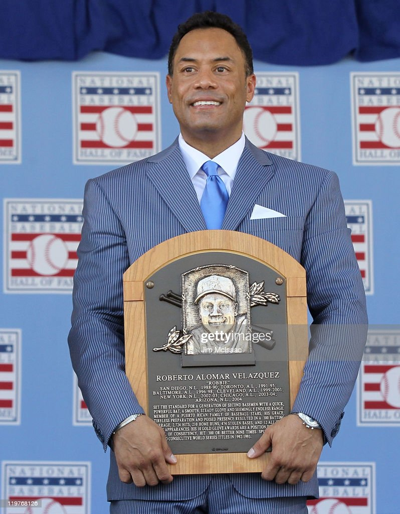 Roberto Alomar poses with his plaques at Clark Sports Center during the Baseball Hall of Fame induction ceremony on July 24, 2011 in Cooperstown, New York. In 17 major league seasons, Alomar tallied 2,724 hits, 210 home runs, 1,134 RBI, a .984 fielding percentage and a .300 batting average.