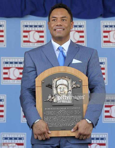 Roberto Alomar poses with his plaques at Clark Sports Center during the Baseball Hall of Fame induction ceremony on July 24 2011 in Cooperstown New...