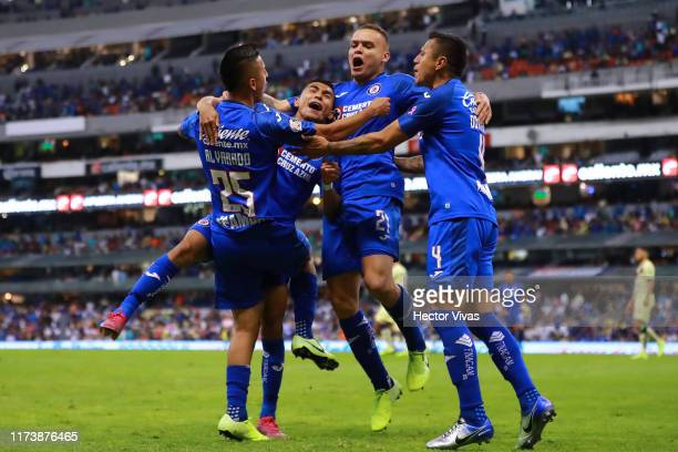 Roberto Alvarado of Cruz Azul celebrates with teammates after scoring the third goal of his team during the 13th round match between Cruz Azul and...