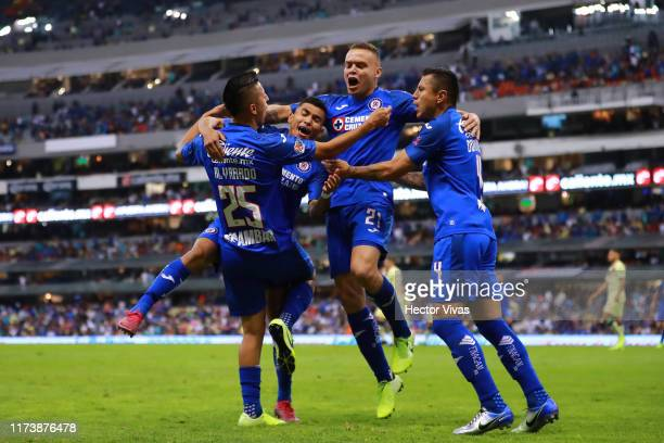 Roberto Alvarado of Cruz Azul celebrates with teammates after scoring the third goal of his team during the 13th round match between Cruz Azul and...