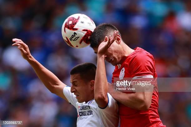 Roberto Alvarado of Cruz Azul struggles for the ball against Javier Guemez of Toluca during the 4th round match between Toluca and Cruz Azul as part...