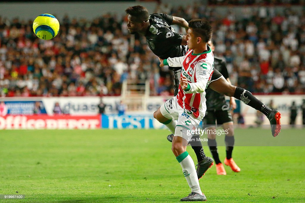 Roberto Alvarado (L) of Necaxa fights for the ball with Aviles Hurtado (R) of Monterrey during the 8th round match between Necaxa and Monterrey as part of the Torneo Clausura 2018 Liga MX at Victoria Stadium on February 17, 2018 in Aguascalientes, Mexico.