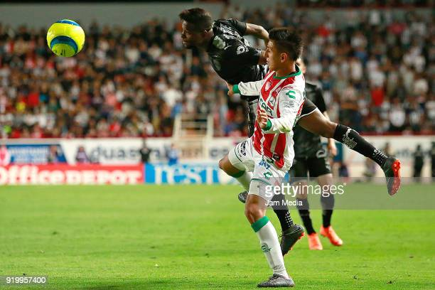 Roberto Alvarado of Necaxa fights for the ball with Aviles Hurtado of Monterrey during the 8th round match between Necaxa and Monterrey as part of...