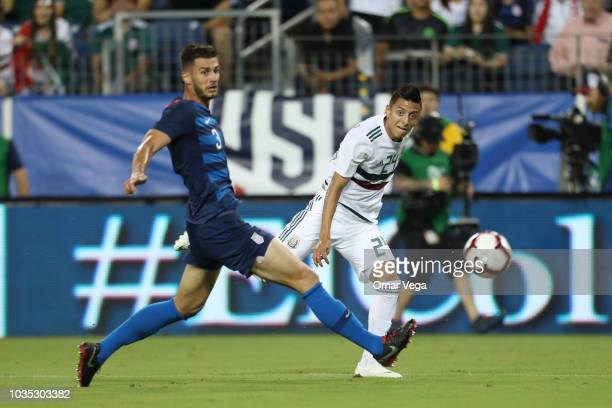 Roberto Alvarado shoots to goal during an international friendly match between Mexico and United States at Nissan Stadium on September 11 2018 in...