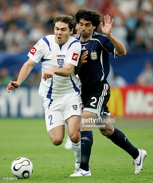 Roberto Ayala of Argentina battles with Ivan Ergic of Serbia Montenegro during the FIFA World Cup Germany 2006 Group C match between Argentina and...